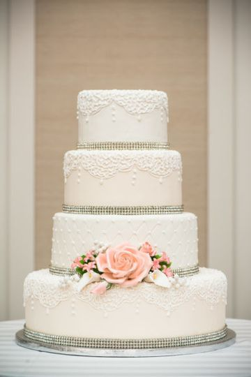 White wedding cake with minimal flower decor
