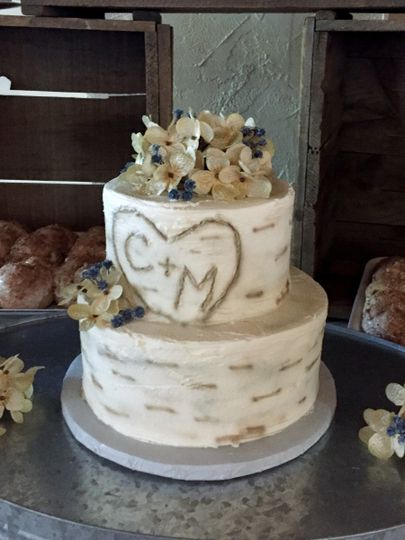 Naked wedding cake with flowers on top