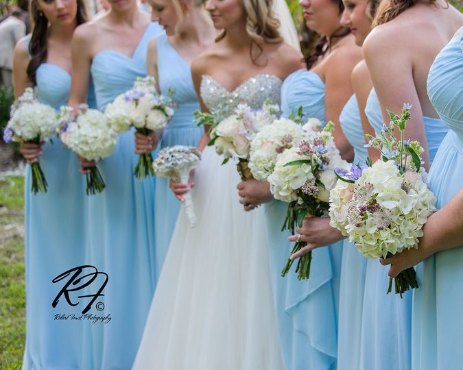 Bridesmaids bouquets of hydrangea, astrantia, twedia, sweetheart roses