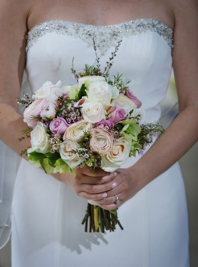 Sweet bridal bouquet of roses, ranunculus, heather, wax flower and hellebores.Susan Leger...