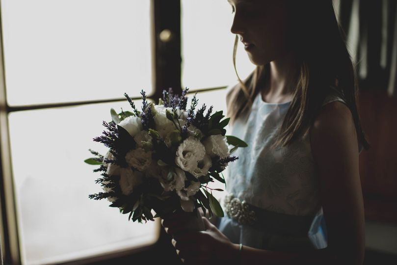 Flower girl and her bouquet