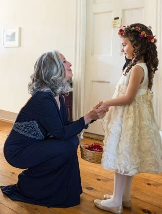 The officiant with the flower girl