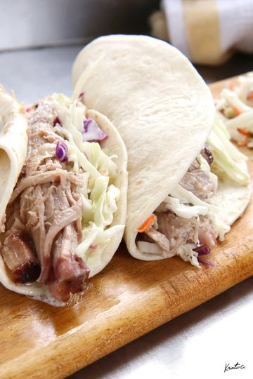 Pulled pork tacos topped with cole slaw