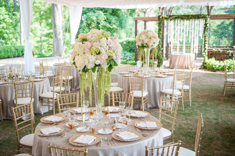 Stunning florals enhance a tented reception in the Manor House Ruins.