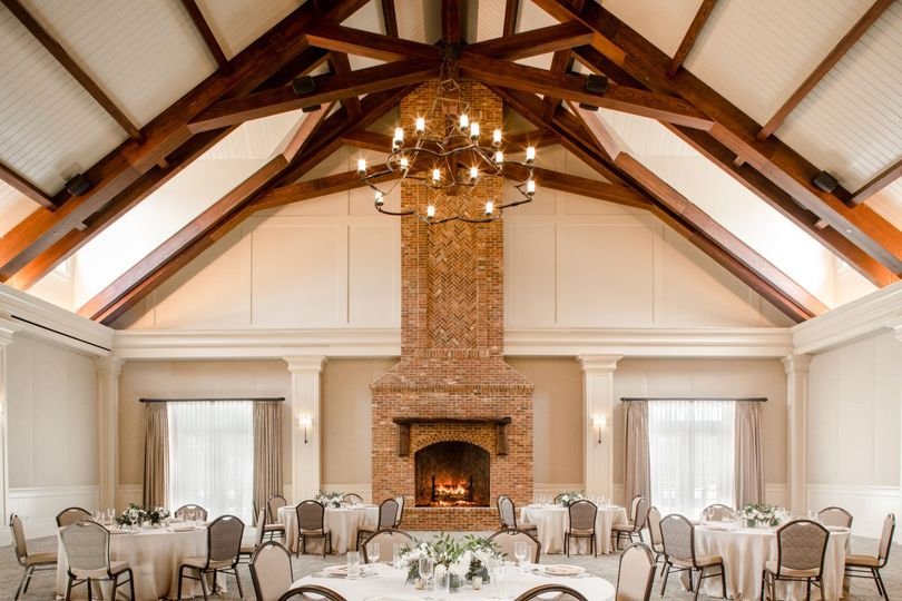The iron chandeliers and exposed beams in the 5,000-square-foot Savannah Ballroom captivate.