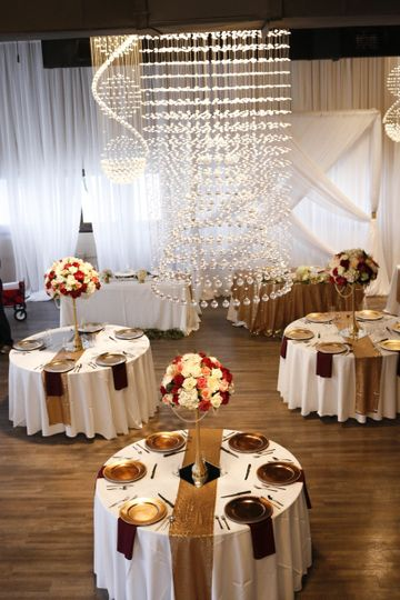 Reception space, tall flower trees and specality linens!
