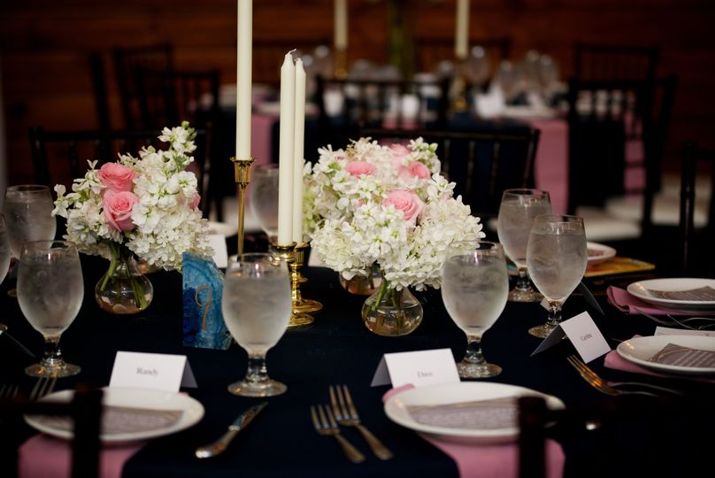 Black reception table with pink decor