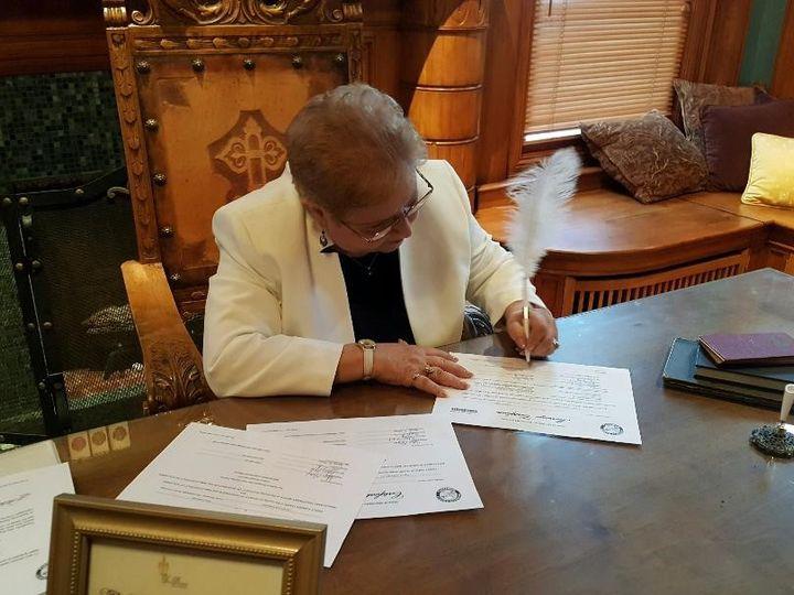 Tmx Signing Marriage License Van Duesen Mansion 51 45170 1557620529 Anoka, MN wedding officiant