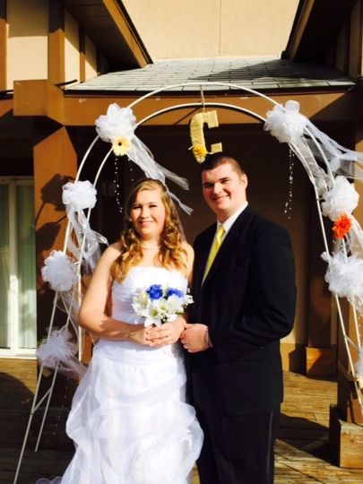 Newlyweds under arch