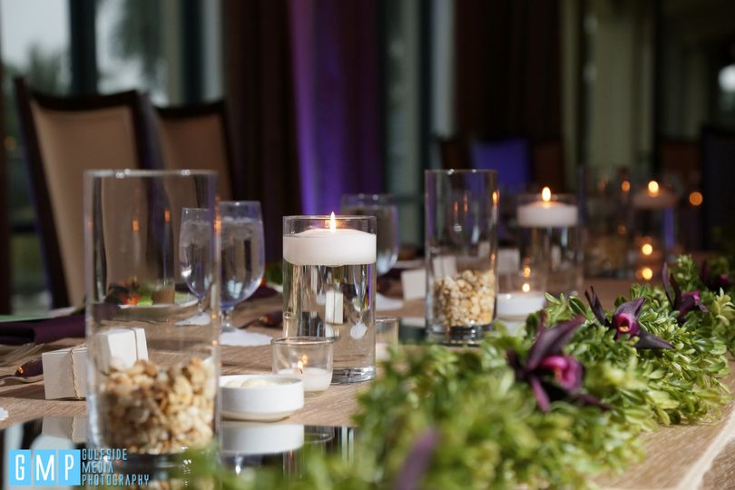 Long table setup with candelight centerpiece