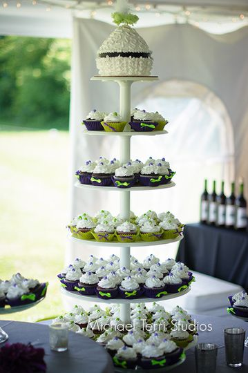 This beautiful cupcake tower will be the talk of your reception! Call for more details.