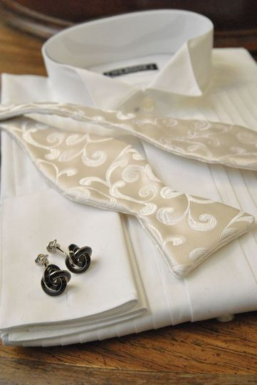 Ike Behar 1/4 inch wing tip pleated shirt. With an ivory silk paisley Dion bow tie and black enamel...
