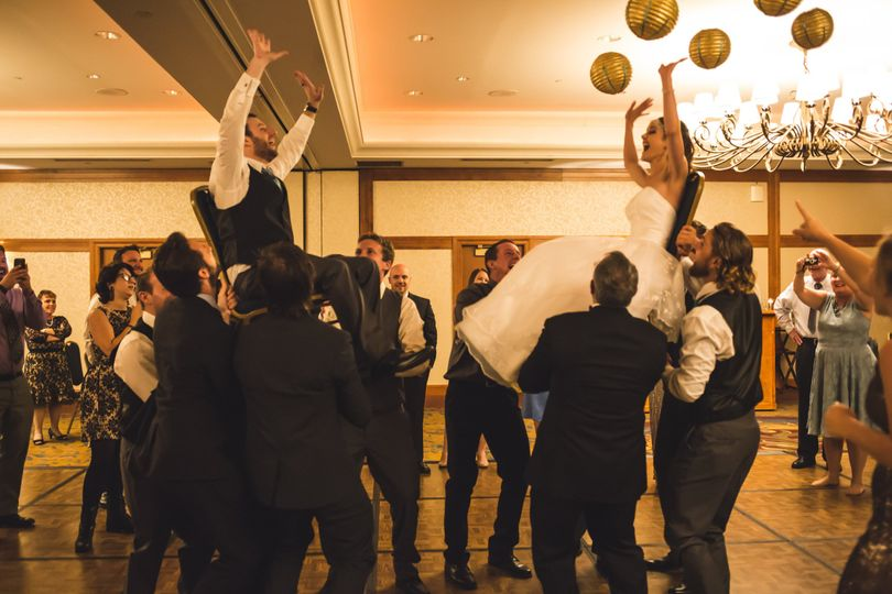 Tossing the bride and groom
