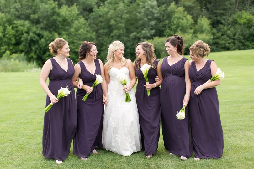 Kelly and her bridesmaids looking fabulous in their deep purple dresses!