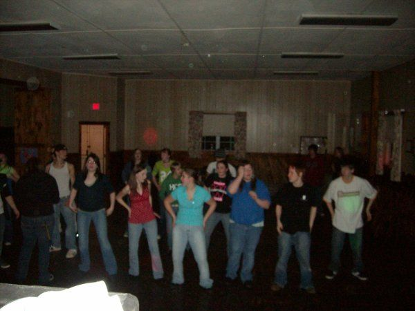 Some teenagers doing the macarena
