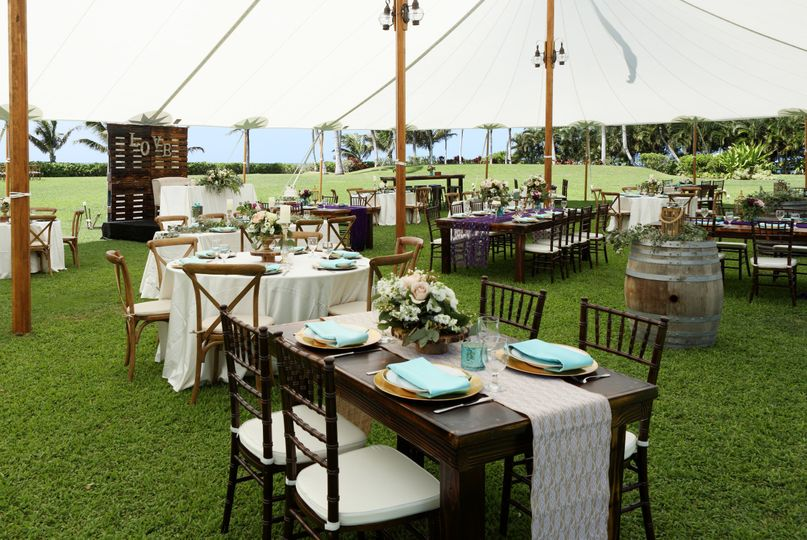 Under the light and beautiful sailcloth | Lovely rustic farm tables, crossback chairs, pallet wall...