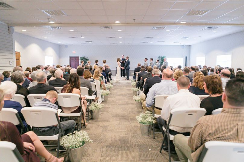 Indoor wedding aisle | Emily Crall Photography