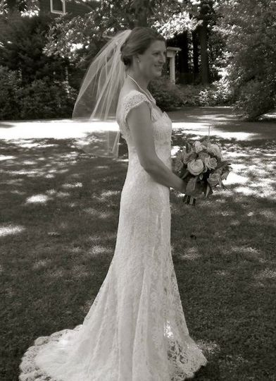A lace dress in a garden wedding