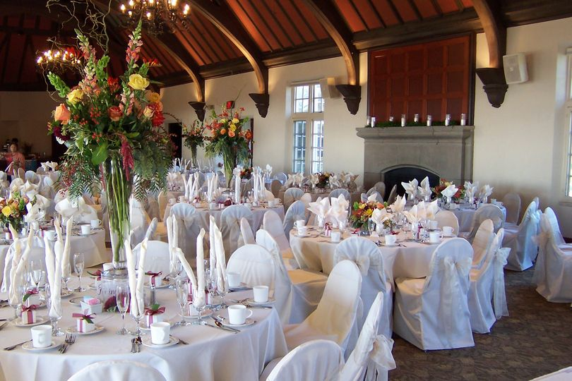 Reception tables and raised floral centerpiece