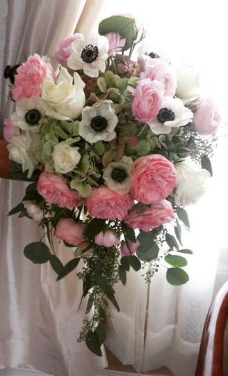 Elegant cascading anemone and garden rose bridayl bouquet with a touch of seeded eucalyptus