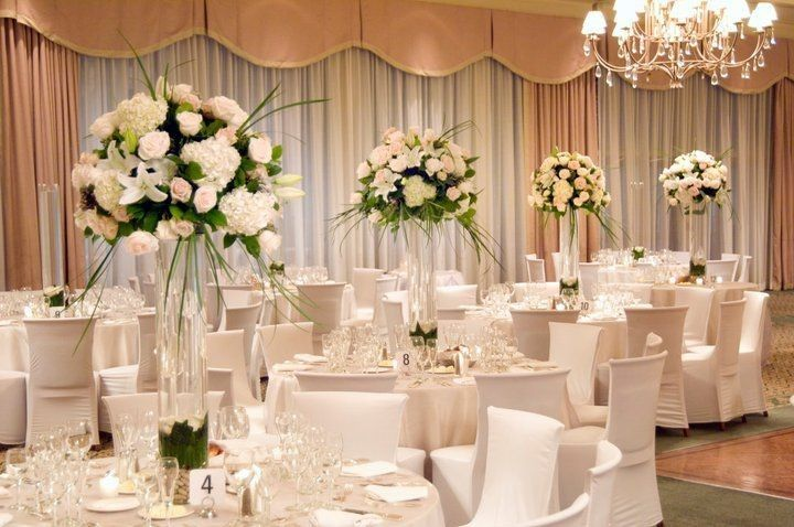 elegant wedding table decorations be equipped with white tablecloths and white chair slipcover in the middle of the table plus floral centerpieces 51 1005470 1557584687
