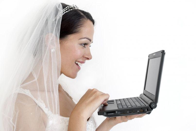 Bride viewing laptop