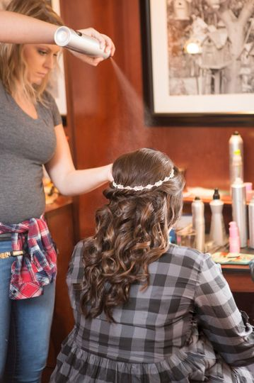 Finishing touches on the hair | Photo by Mike Curtis Weddings