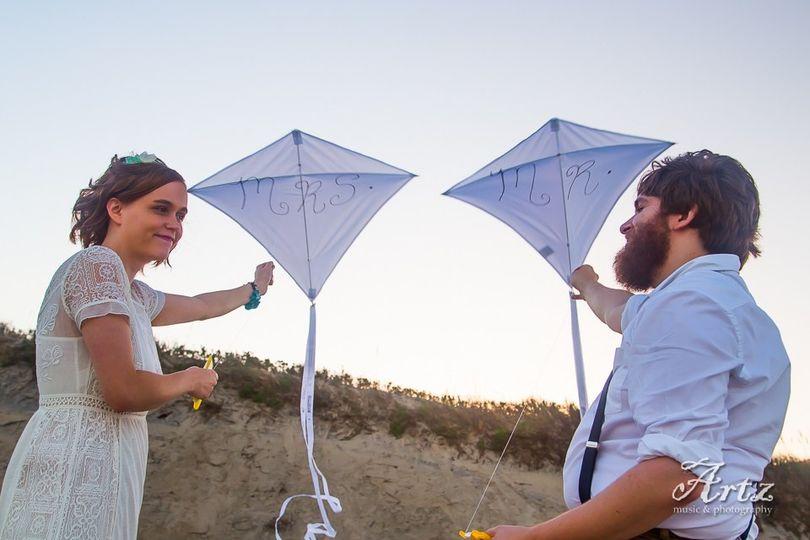 Couple fly kites