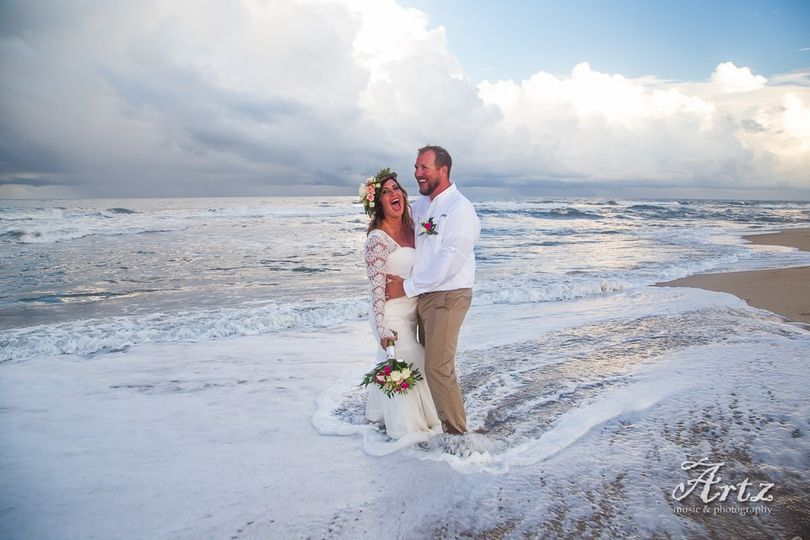 Couple hit by the waves