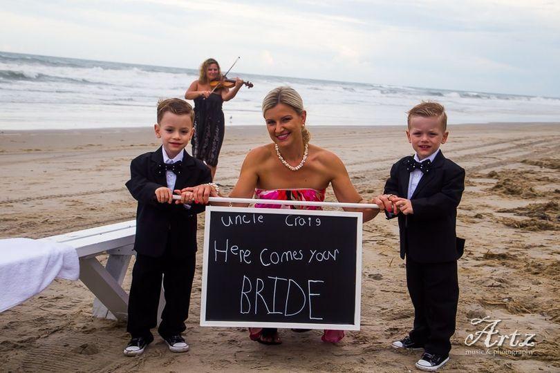 Bride holding a chalkboard sign