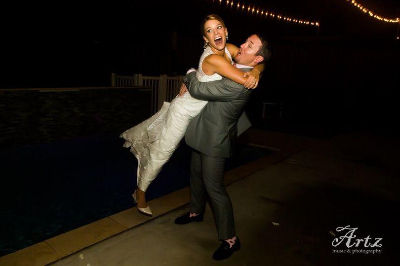 Groom lifts his bride
