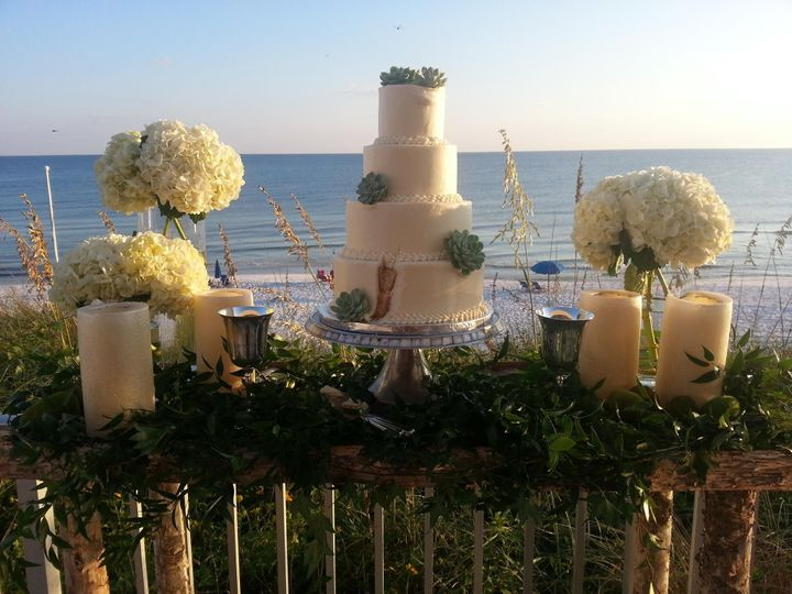 4-tier wedding cake and bouquets