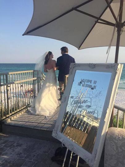 Newlyweds overlooking the beach