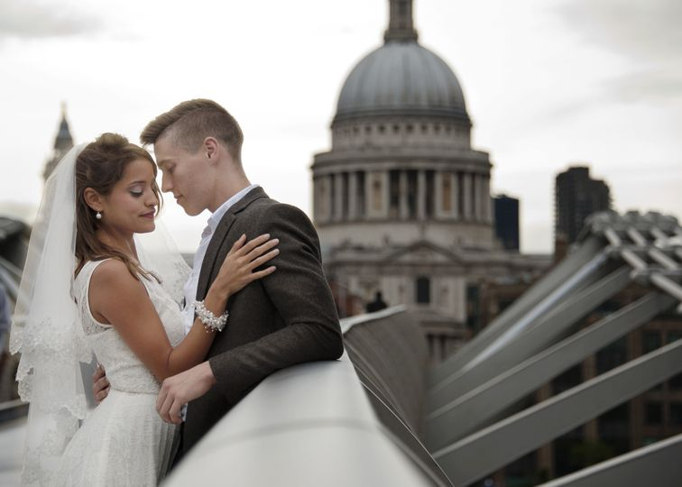 Bride and groom at Millenium Bridge in London.