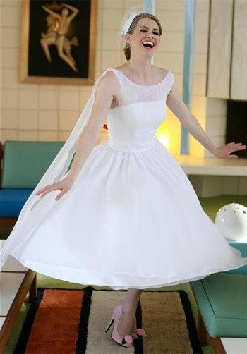 The Marin CountyHow much fun you'll have in this romantic 50's classic! This gown is made from soft...
