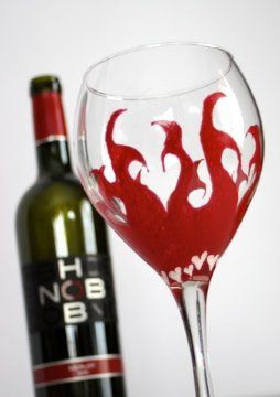 Custom hand painted hearts on fire wine goblet. Each glass is personalized at the base of the stem...