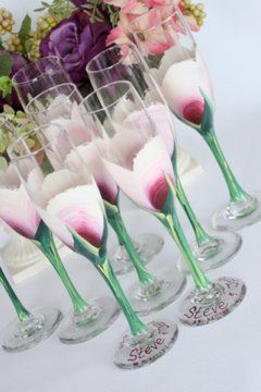 Custom hand painted berry colored rose bud flutes for the head table at your wedding reception.