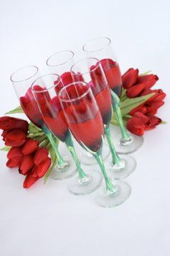 Custom hand painted red rose bud flutes for the head table at your wedding reception.