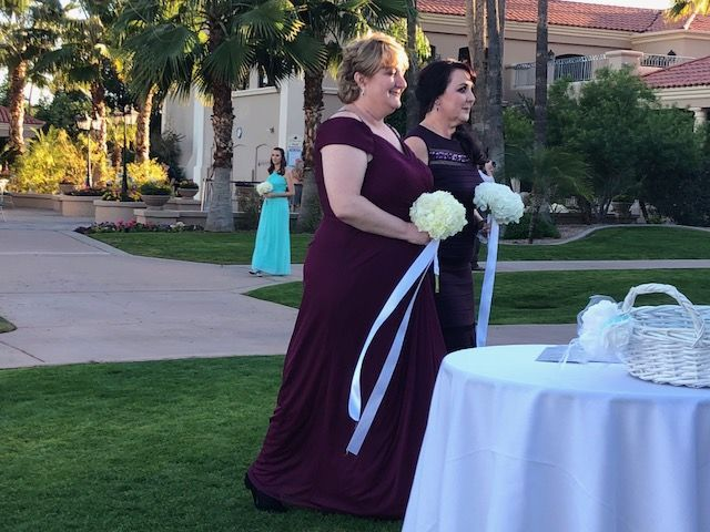 Touching moment when both brides' moms carried half her bouquet.