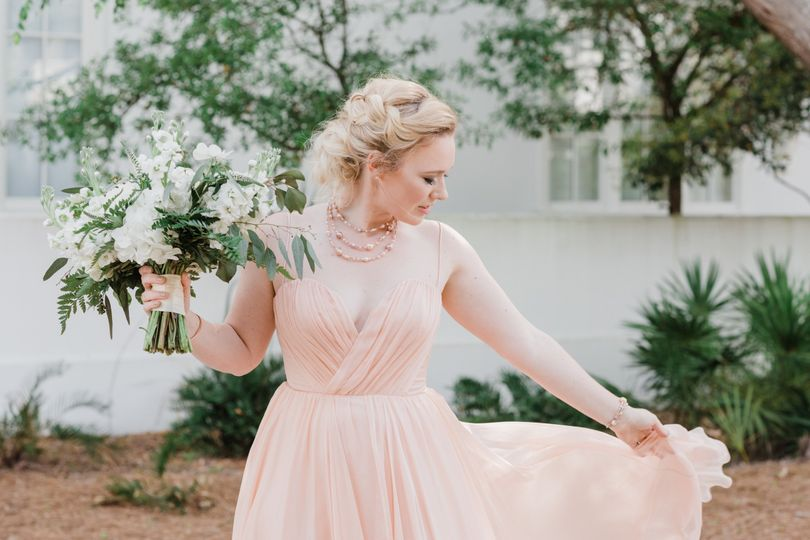Bride in pink with her bouquet