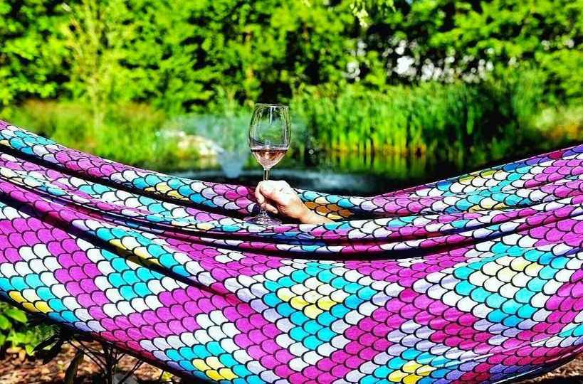 Relax with a glass in one of our hammocks.