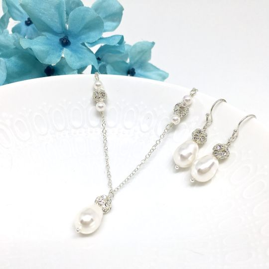 The pendant was created with a 10mm teardrop Swarovski pearl topped with a 6mm crystal ball bead....