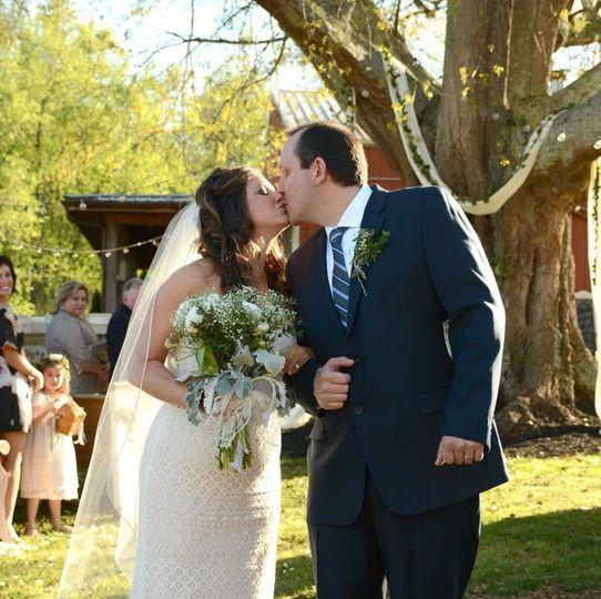 The newlyweds kiss