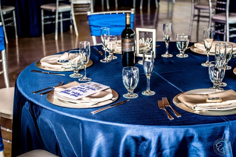 Blue table linen and chair band