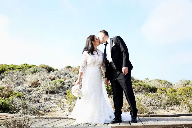 Sharing a kiss DLGM Weddings