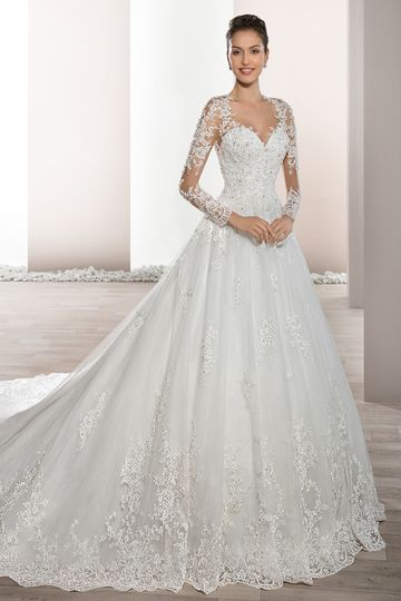 Style 732 	Delicately beaded appliques embellish this romantic Tulle Ball gown with Sweetheart...
