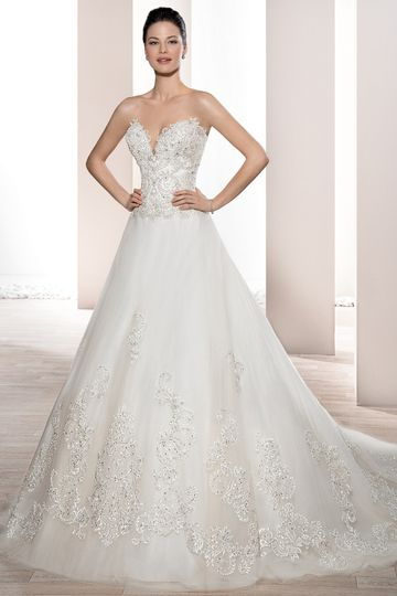 Style 733 	This timeless strapless, Tulle gown with Deep sweetheart neckline and lace-up back is...