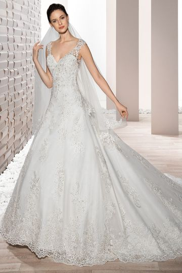 Style 731   This classic A-line gown with Sweetheart neckline features sheer lace cap sleeves...