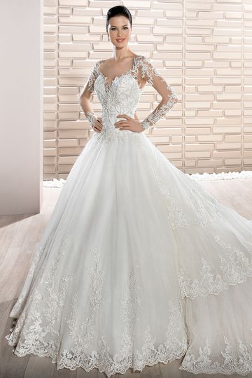 Style 729 	Romance meets drama in this exquisite, Tulle Ball gown featuring a Sweetheart...
