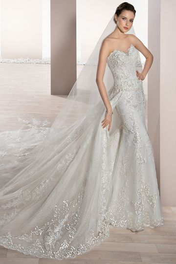 Style 728  	A Magnificent, optional detachable train adds a traditional touch to this strapless,...